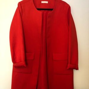 Bright red trench coat
